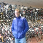 Phil Arundale in front of bicycles at the bikeshop